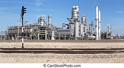 Petrochemical industry and railway - A petrochemical plant,...
