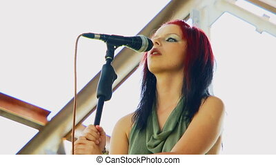 Beautiful singer - Beautiful girl with multicolored hair,...