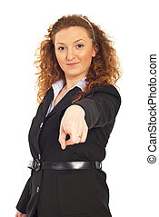 Smiling executive pointing to you - Smiling business woman...