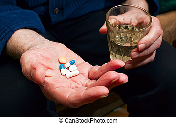 Hand With Pills - close-up old mans hands with pills and...