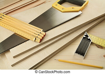 Wood working tools on a wooden boards background. Including...