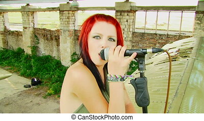 Girl singer - Beautiful girl with multicolored hair, sings...