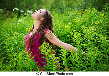 woman on green grass field close portrait