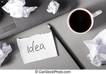 business creativity concept. Laptop, sheets of paper and...