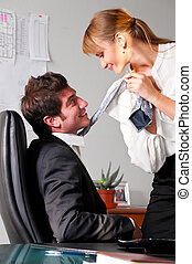 flirting at office - businesswoman is seducing her boss at...