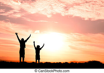 two children jumping silhouette