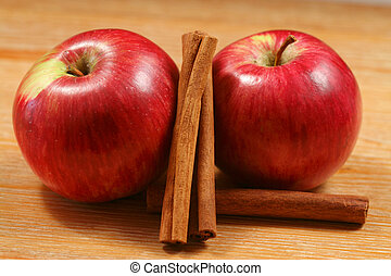 Two apples with cinnamon - Apples and cinnamon sticks - two...