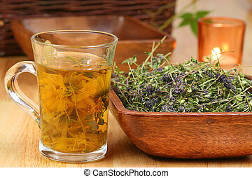 Herbs in glass and bowl - Glass of different infused herbs...