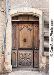 Old French door - Old closed wooden French door with knocker