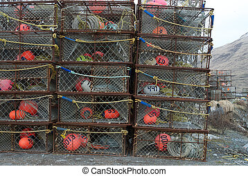 Crab pots stacked high waiting to be loaded in Dutch Harbor,...
