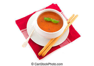 Tomato soup - Portion tomato soup in white bowl with soup...