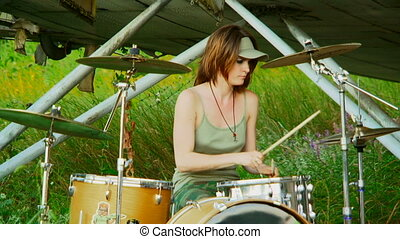 Girl drummer - Beautiful girl plays drums.