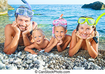 Ready To Snorkle - Happy family on beach with snorkles ready...