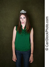 Woman With Tiara Sticks Out Her Tongue