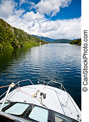 Scenic lake cruise - Cruise ship at Lake Manapouri in the...