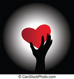Red heart - Conceptual image of the heart and hand