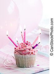 Birthday cupcake - Cupcake decorated with six pink candles