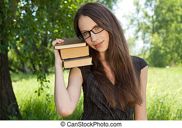 happy young student girl with books in park