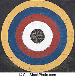 Weathered old painted colorful wooden target board.