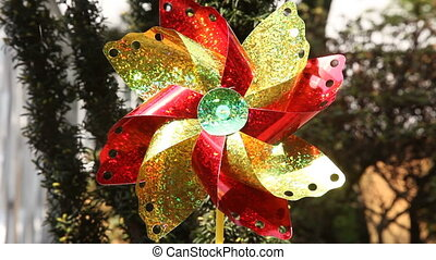 Pinwheel is a simple childs toy made of a wheel of paper or...