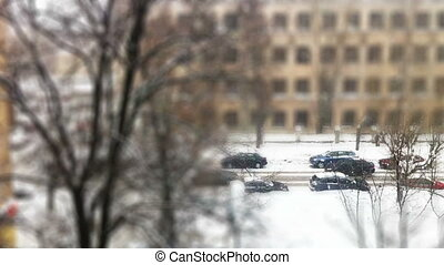 City street during snowfall, time lapse aerial view