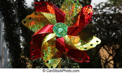 Pinwheel is a simple child\'s toy made of a wheel of paper...