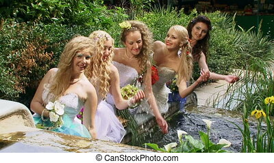 Group of brides - Beautiful girls in wedding dresses squirt...