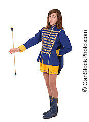 Teenage majorette in uniform twirling a baton, isolated on...