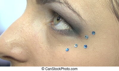 Work fine makeup artist - Makeup artist puts girl model...