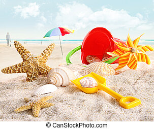 Childrens beach toys at the beach - Assortment of childrens...