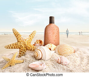 Suntan lotion and seashells on the beach - Suntan lotion and...