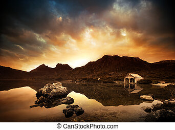 Explosive Lake Sunset - Sunset over peaceful lake with...