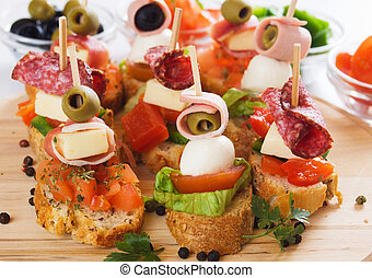 Canape with italian food ingredients - Bruschetta bread with...