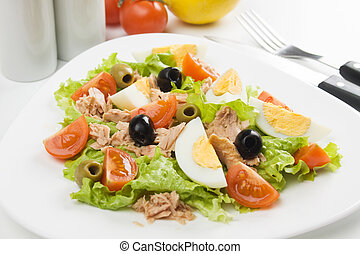 Egg salad with tuna meat, cherry tomato, olives and lettuce