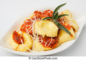 Tortellini pasta with tomato sauce and parmesan cheese -...