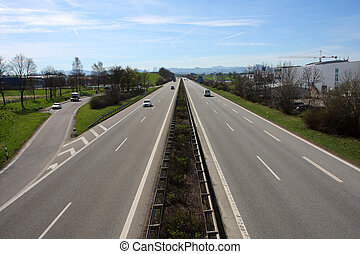 autobahn - straight autobahn going to the mountains at the...