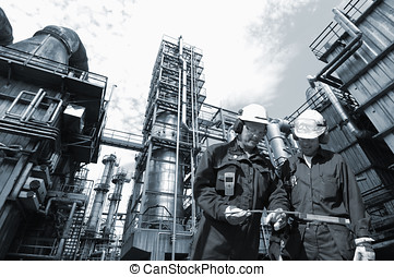 oil, gas and fuel installation - two workers with pipeline...