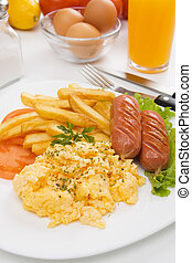 Scrambled eggs with sausage and french fries