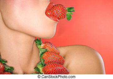 Strawberry kisses - Woman with strawberry in mouth on red...