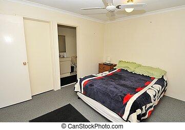 Simple spacious bedroom