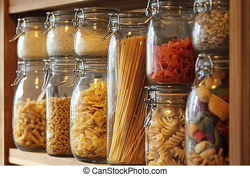 Dried pasta in jars on a shelf - Photo of dried pasta in...