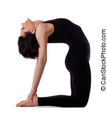 woman back bends yoga - camel pose - young woman training in...