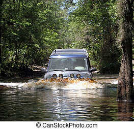 Land Rover Discovery - crossing a river in central florida