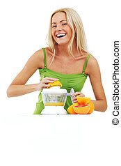 woman squeezes juice by juicer