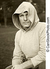 man in hood - A portrait of a handsome man wearing a hooded...