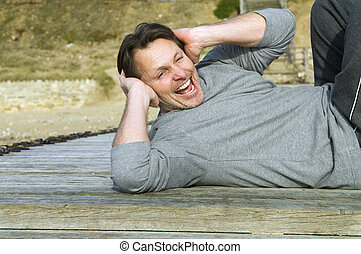 Man doing exercises - A happy forties man performing...