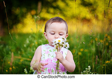 Little girl with the daisy