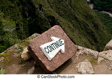 continue sign - The picture of the continue sign in...