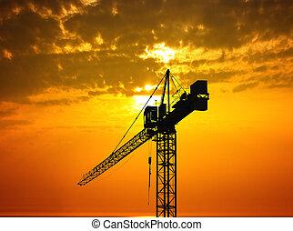 Crane and beautiful sunset