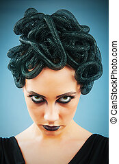Woman depicting the concept og Evil Medusa Gorgon